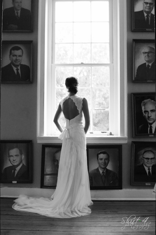 Liza stands in front of the window in Demosthenian Hall