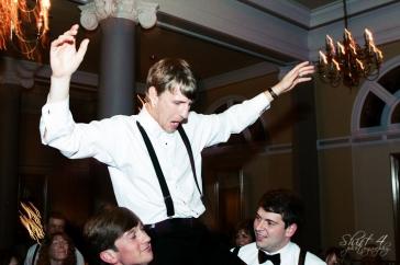 The groomsmen lift Joel on their shoulders