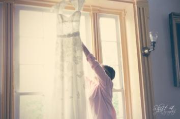 Liza fixing her wedding dress