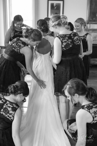 The bridal party prepares Liza for the ceremony