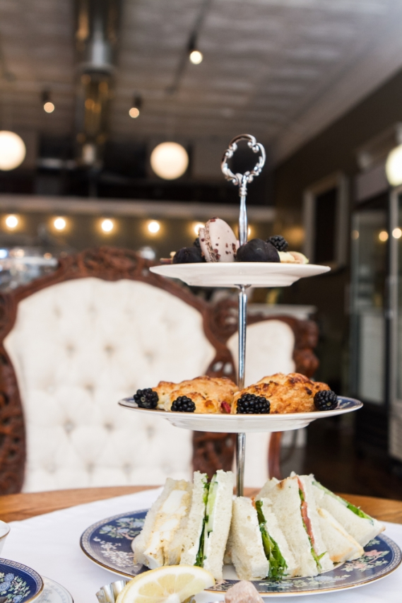 High Tea at Tipple + Rose includes scones, sandwiches, sweets, and a pot of tea.