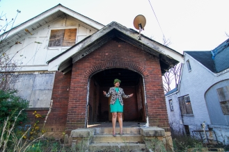 December 4, 2015 - 874 Dill Ave -- 26 year-old Malika Whitley stands in front of her old burnt out home. The last place she lived before experiencing homelessness.